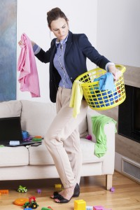 Businesswoman collecting laundry at home